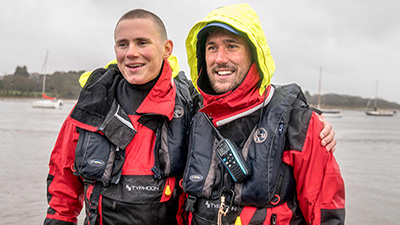 Ocean Brothers at the finish line, wearing their Typhoon PS330 drysuits and Kru Lifejackets